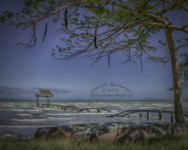 Sarteneja seaside with canoe, by Carol Quinn. ID 2CQ2268-71 rev 1b