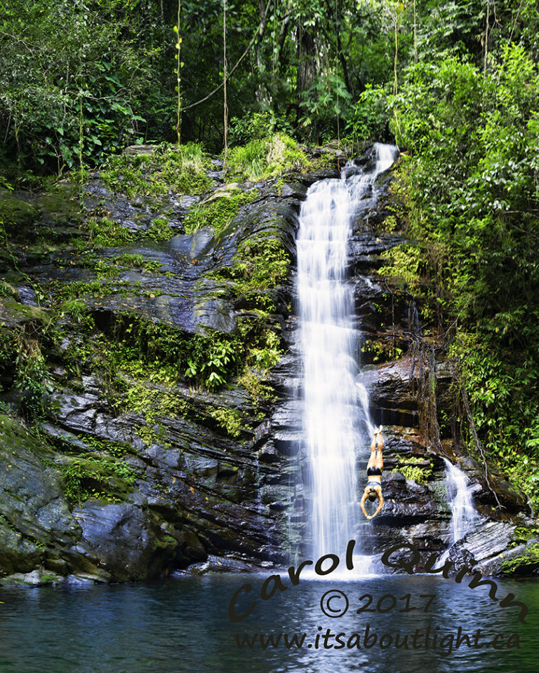 Upper falls with diver, by Carol Quinn. La Milpa is a conservation and research area, and also an Archeological site for Mayan ruins. ID 2CQ0755-62 rev 1c